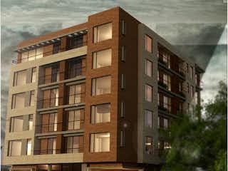 Un edificio alto sentado al lado de una calle en Venetto