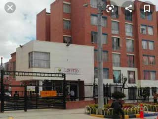 Un edificio con un reloj en el costado en VENTA APARTAMENTO SOACHA C COMERCIAL VENTURA CONJUNTO LORETTO
