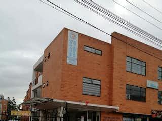 Un edificio de ladrillo con un letrero en la calle en Apartamento en venta en Calandaima con Jardín...