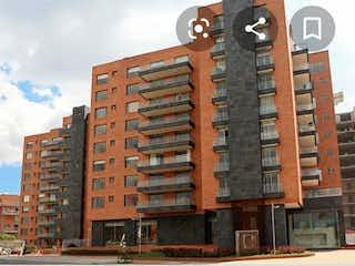 Un gran edificio de ladrillo con un reloj en él en Apartamento en venta en Carlos Lleras de 45m²