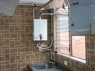 Una cocina con una estufa y un fregadero en Apartamento en venta en Andalucía 50m²