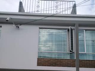 Una ventana que está delante de un edificio en VENTA/PERMUTA CASA RINCN SANTO FONTIBON