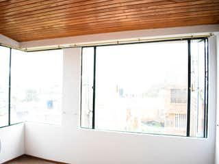 Una ventana con cortinas que cuelgan de la ventana en Casa en venta en Casco Urbano Sopó 92m²