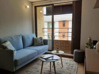 Una sala de estar llena de muebles y una ventana en Apartamento en venta en Lijacá de 2 alcoba