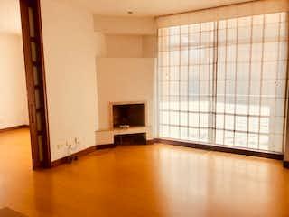 Una vista de una sala de estar con un gran ventanal en OPORTUNIDAD! APTO MODERNO 2 HAB 76M2 - CHICO III CALLE 97