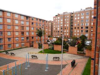 Una calle de la ciudad con edificios altos en el fondo en Apartamento En Venta En Bogota San José De Bavaria