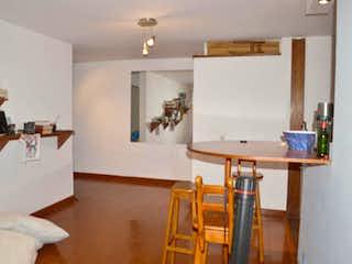 Una sala de estar llena de muebles y una mesa de madera en Apartamento En Venta En Bogota Cedritos-Usaquén