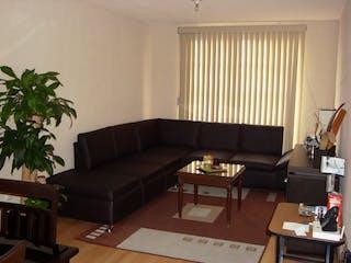 Una sala de estar llena de muebles y una televisión de pantalla plana en Departamento en Colonia Juarez