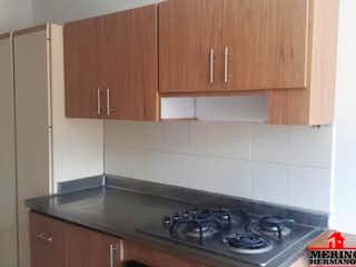 Una cocina con una estufa y un fregadero en RINCÓN DE MIRAFLORES