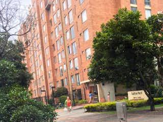Un edificio de ladrillo rojo con una boca de incendios roja en Apartamento en venta en Carlos Lleras de 3 habitaciones