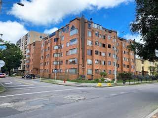 Una calle de la ciudad llena de edificios y árboles en Apartamento en venta en La Calleja, 127m² con Bbq...