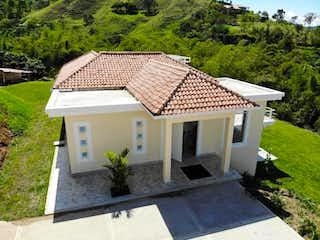 Una mesa blanca con un paraguas blanco en la parte superior en Casa En Venta En La Vega La Vega