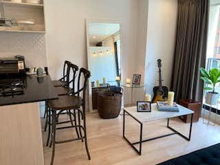 Una sala de estar llena de muebles y una mesa en Apartamento En Venta En Bogota Cedritos