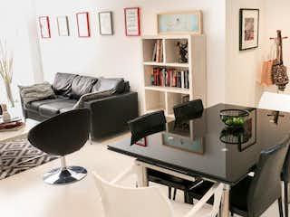 Una sala de estar llena de muebles y decoración en Apartamento en venta en El Virrey de una habitacion