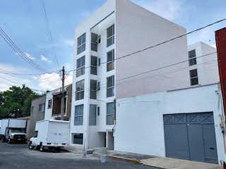 Un edificio blanco con un letrero en la calle en Venta de departamento en Cda Doctor Duran. Col. Doctores.