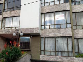 Un edificio de ladrillo con un reloj en él en Apartamento En Venta En Bogota Cedro Golf-Usaquén