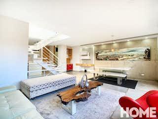 Una sala de estar llena de muebles y una mesa en Apartamento en venta en El Virrey, de 165mtrs2