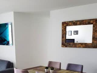Una habitación con una mesa y una mesa en Apartamento en venta en Castropol de tres habitaciones