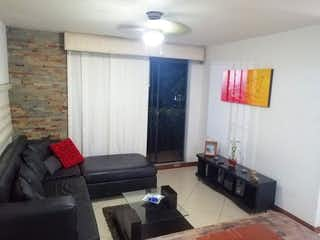 Una sala de estar llena de muebles y una chimenea en Apartamento en venta en San Diego, de 71mtrs2