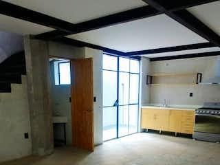 Una vista de una cocina desde el pasillo en INCREIBLES LOFTS EN EDIFICIO SUSTENTABLE