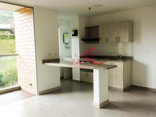 Una cocina con una estufa de fregadero y nevera en Unidad Infinito