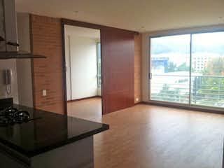 Una cocina con un gran ventanal en ella en Apartamento En Venta En Bogota San Patricio-Usaquén