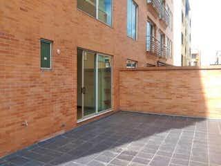 Un edificio de ladrillo con una ventana y una ventana en Apartamento En Venta En Bogota San Patricio-Usaquén