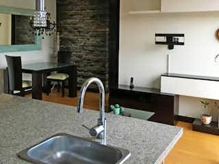 Un cuarto de baño con lavabo y un espejo en Apartamento En Venta En Bogota Chico Norte