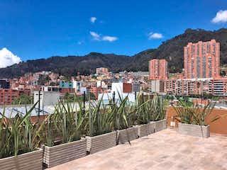 Una vista de una ciudad con un edificio en el fondo en Apartamento En Venta En Bogota La Salle