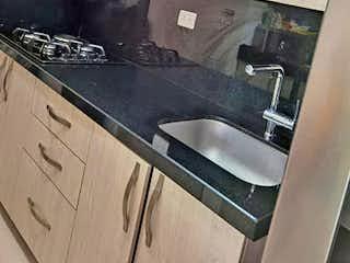 Una cocina con un fregadero y un horno de cocina en Apartamento en Venta SAN GERMAN