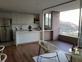 Una cocina con una mesa y sillas en ella en Apartamento en Venta SURAMERICA