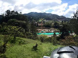 Una vista de un camino en medio de un campo en Lote en Venta EL RETIRO