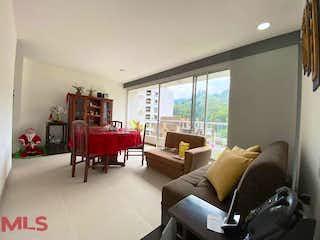 Una sala de estar llena de muebles y una televisión de pantalla plana en Manzana Once