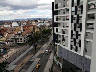 Una calle de la ciudad llena de muchos edificios altos en Apartaestudio En Venta En Bogota Chapinero Central