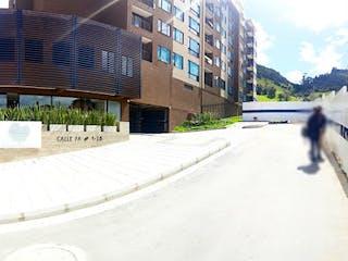 Una vista de una calle de la ciudad con un edificio en el fondo en Apartamento en Venta LA CALERA