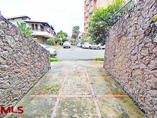 Una pared de piedra con un banco en el lado en No aplica