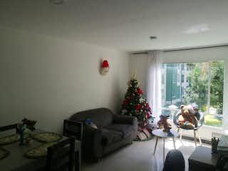 Una sala de estar con un árbol de navidad en ella en VENTA DE APARTAMENTO PRADERA NORTE