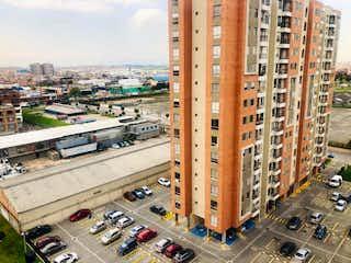 Una calle de la ciudad llena de muchos edificios altos en Apartamento En Arriendo/venta En Bogota Hayuelos