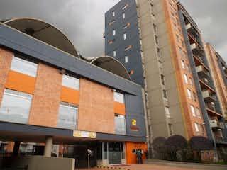 Un edificio con un reloj en el costado en Apartamento en venta en Nueva Marsella 70m²