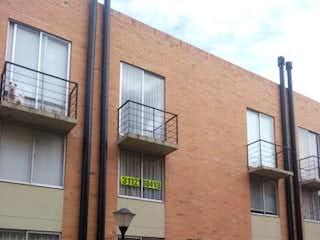 Un gran edificio de ladrillo con un reloj en el lado en Casa en venta en Casco Urbano Funza 73m² con Bbq...