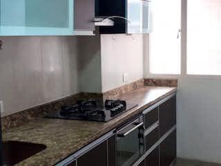 Una cocina con un fregadero y un horno de cocina en Apartamento en venta en El Encanto de 3 alcoba