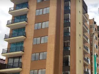 Un edificio alto sentado al lado de un edificio alto en Apartamento en venta en Casco Urbano Sopó de 3 habitaciones