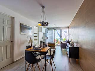 Una sala de estar llena de muebles y una ventana en Elite Living Zaragoza