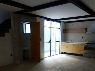 Una habitación que tiene una ventana en ella en HERMOSOS DEPARTAMENTOS DUPLEX EN EDIFICIO RESTAURADO