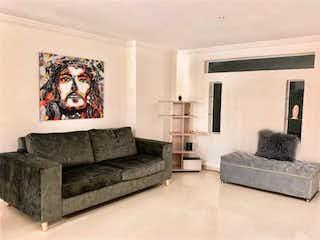 Una sala de estar llena de muebles y un sofá en Apartamento en Venta Laureles Medellin Antioquia