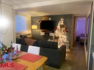 Una sala de estar llena de muebles y una chimenea en Manzanillo