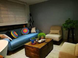 Una sala de estar llena de muebles y un sofá en Apartamento En Venta En Mosquera Ciudad Sabana