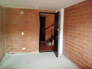 Una puerta que está abierta a un edificio en Apartamento En Venta En Bogota Bosques De Bogotá