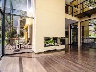 Una vista de una sala de estar y una sala de estar en El Candil De Loreto