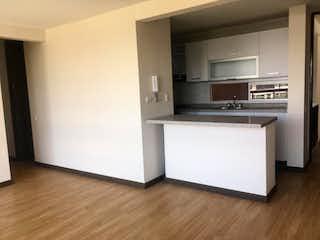 Una cocina con una estufa blanca encima del horno en Apartamento En Venta En Bogota Lijaca 2 habitaciones, 2 baños para estrenar.